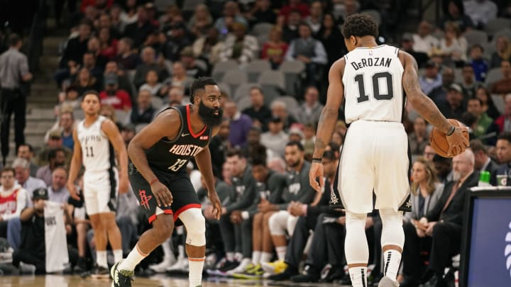 SAN ANTONIO, TX – DECEMBER 3: James Harden #13 of the Houston Rockets plays defense against DeMar DeRozan #10 of the San Antonio Spurs (Photos by Darren Carroll/NBAE via Getty Images)