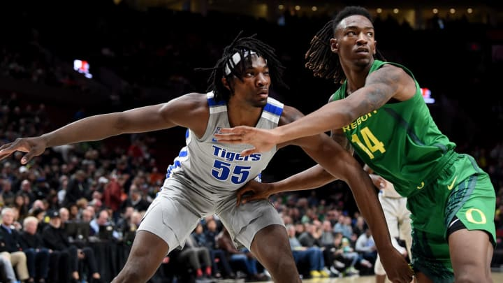 PORTLAND, OREGON – NOVEMBER 12: Precious Achiuwa #55 of the Memphis Tigers and C.J. Walker #14 of the Oregon Ducks battle for position during the first half of the game at Moda Center (Photo by Steve Dykes/Getty Images)