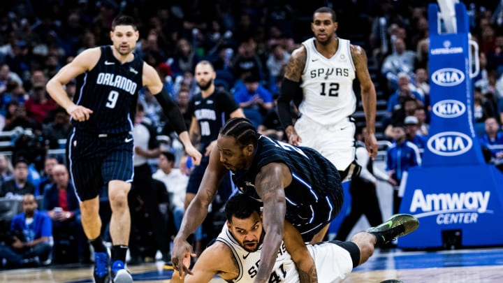 ORLANDO, FLORIDA – NOVEMBER 15: Al-Farouq Aminu #2 of the Orlando Magic and Trey Lyles #41 of the San Antonio Spurs fight for control in the second quarter at Amway Center (Photo by Harry Aaron/Getty Images)