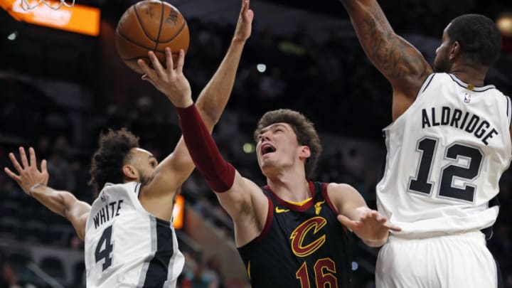 SAN ANTONIO, TX - DECEMBER 12: Cedi Osman #16 of the Cleveland Cavaliers drives between Derrick White #4 of the San Antonio Spurs and LaMarcus Aldridge #12 of the San Antonio Spurs in the first half at AT&T Center on December 12, 2019 in San Antonio, Texas. NOTE TO USER: User expressly acknowledges and agrees that , by downloading and or using this photograph, User is consenting to the terms and conditions of the Getty Images License Agreement. (Photo by Ronald Cortes/Getty Images)