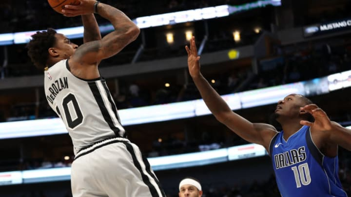 DALLAS, TEXAS - NOVEMBER 18: DeMar DeRozan #10 of the San Antonio Spurs takes a shot against Dorian Finney-Smith #10 of the Dallas Mavericks in the second half at American Airlines Center on November 18, 2019 in Dallas, Texas. NOTE TO USER: User expressly acknowledges and agrees that, by downloading and or using this photograph, User is consenting to the terms and conditions of the Getty Images License Agreement. (Photo by Ronald Martinez/Getty Images)