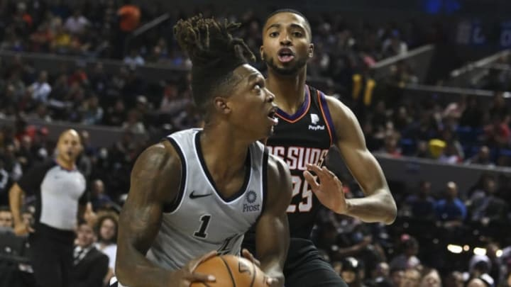 San Antonio Spurs' US shooting guard Lonnie Walker (L) vies for the ball with Phoenix Suns' US small forward Mikal Bridges during an NBA Global Games basketball match in Mexico City (Photo by PEDRO PARDO / AFP) (Photo by PEDRO PARDO/AFP via Getty Images)