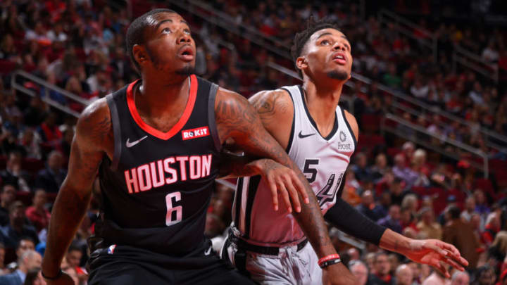 HOUSTON, TX - DECEMBER 16 : Gary Clark #6 of the Houston Rockets and Dejounte Murray #5 of the San Antonio Spurs fight for position during the game on December 16, 2019 at the Toyota Center in Houston, Texas. NOTE TO USER: User expressly acknowledges and agrees that, by downloading and or using this photograph, User is consenting to the terms and conditions of the Getty Images License Agreement. Mandatory Copyright Notice: Copyright 2019 NBAE (Photo by Bill Baptist/NBAE via Getty Images)