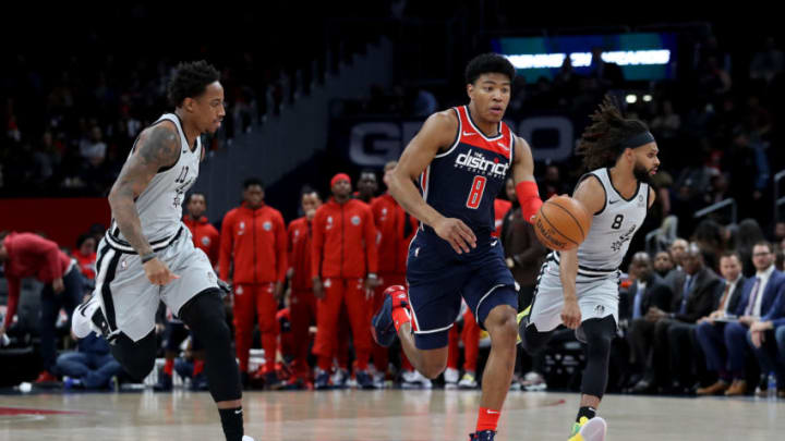 WASHINGTON, DC - NOVEMBER 20: Rui Hachimura #8 of the Washington Wizards dribbles the ball in front of Patty Mills #8 and DeMar DeRozan #10 of the San Antonio Spurs at Capital One Arena on November 20, 2019 in Washington, DC. NOTE TO USER: User expressly acknowledges and agrees that, by downloading and/or using this photograph, user is consenting to the terms and conditions of the Getty Images License Agreement. (Photo by Rob Carr/Getty Images)