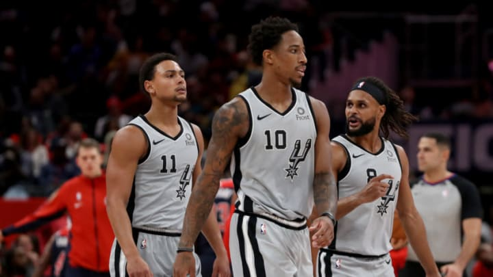 Bryn Forbes, DeMar DeRozan, and Patty Mills of the San Antonio Spurs. (Photo by Rob Carr/Getty Images)