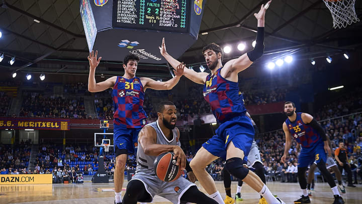 BARCELONA, SPAIN – DECEMBER 17: Jordan Taylor (C) of Asvel Villeurbane competes for the ball with Ante Tomic (R) and NBA Draft Prospect Leandro Bolmaro (L) of Barcelona. (Photo by Pablo Morano/MB Media/Getty Images)