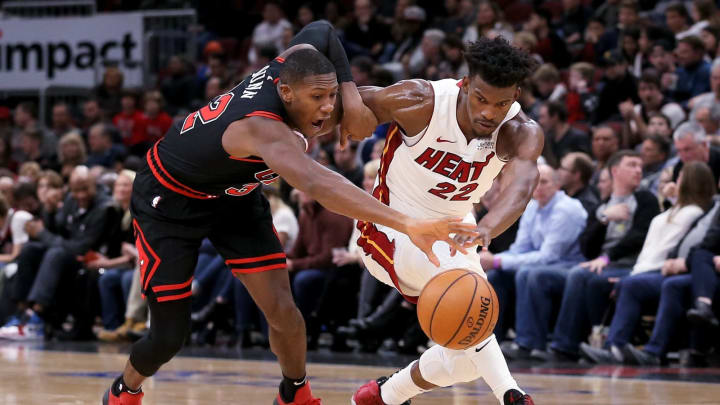 Kris Dunn of the Chicago Bulls and Jimmy Butler #22 of the Miami Heat. (Photo by Dylan Buell/Getty Images)