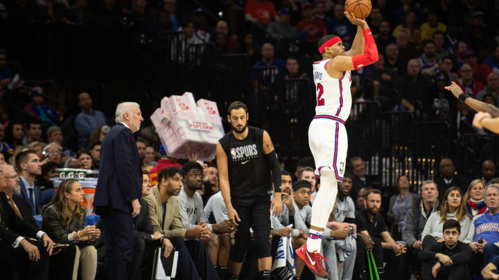 PHILADELPHIA, PA – NOVEMBER 22: Marco Belinelli #18 of the San Antonio Spurs walks past Tobias Harris #12 of the Philadelphia 76ers as he attempts a shot at the Wells Fargo Center (Photo by Cameron Pollack/Getty Images)