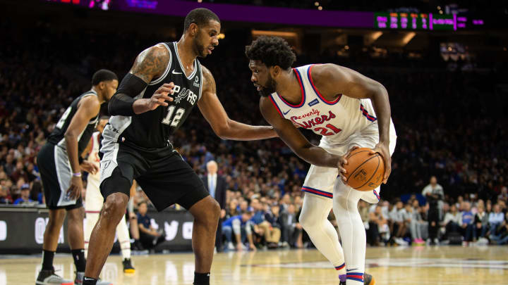PHILADELPHIA, PA – NOVEMBER 22: Joel Embiid #21 of the Philadelphia 76ers dribbles against LaMarcus Aldridge #12 of the San Antonio Spurs during the third quarter of a game at the Wells Fargo Center on November 22, 2019, in Philadelphia, Pennsylvania. (Photo by Cameron Pollack/Getty Images)