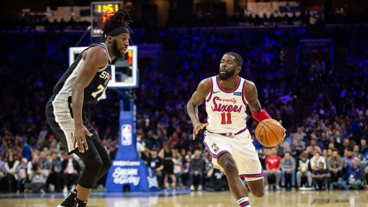 PHILADELPHIA, PA – NOVEMBER 22: James Ennis III #11 of the Philadelphia 76ers dribbles past DeMarre Carroll #77 of the San Antonio Spurs (Photo by Cameron Pollack/Getty Images)