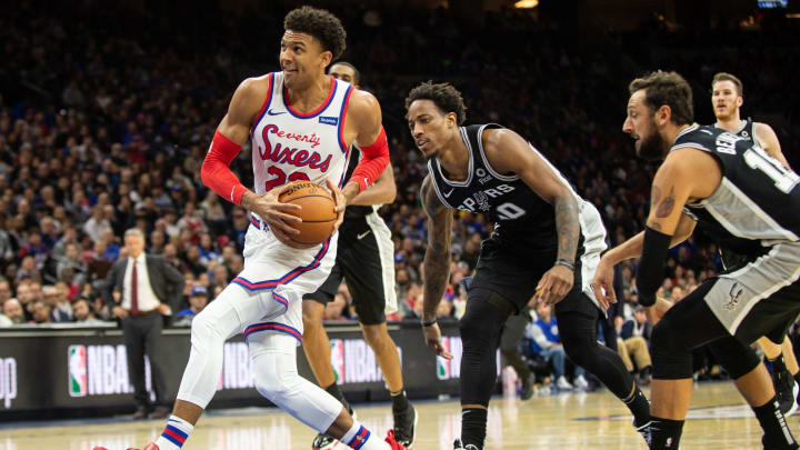 PHILADELPHIA, PA – NOVEMBER 22: Matisse Thybulle #22 of the Philadelphia 76ers drives to the basket past DeMar DeRozan #10 of the San Antonio Spurs. (Photo by Cameron Pollack/Getty Images)