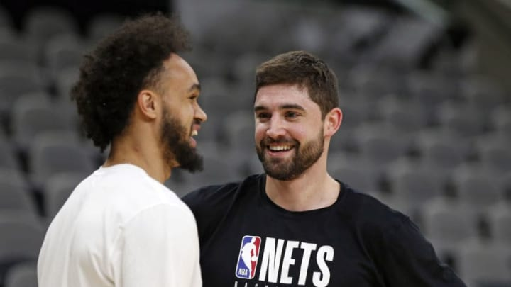 SAN ANTONIO, TX - DECEMBER 19: Joe Harris #12 of the Brooklyn Nets chats with Derrick White #4 of the San Antonio Spurs before the start of their game at AT&T Center on December 19, 2019 in San Antonio, Texas. NOTE TO USER: User expressly acknowledges and agrees that , by downloading and or using this photograph, User is consenting to the terms and conditions of the Getty Images License Agreement. (Photo by Ronald Cortes/Getty Images)