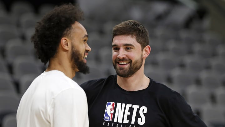 SAN ANTONIO, TX – DECEMBER 19: Joe Harris #12 of the Brooklyn Nets chats with Derrick White #4 of the San Antonio Spurs before the start of their game at AT&T Center on December. (Photo by Ronald Cortes/Getty Images)