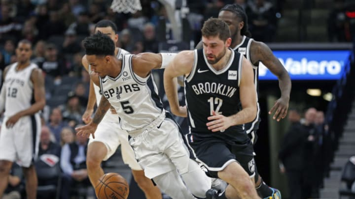 SAN ANTONIO, TX - DECEMBER 19: Dejounte Murray #5 of the San Antonio Spurs drives past Joe Harris #12 of the Brooklyn Nets in the first half at AT&T Center on December 19, 2019 in San Antonio, Texas. NOTE TO USER: User expressly acknowledges and agrees that , by downloading and or using this photograph, User is consenting to the terms and conditions of the Getty Images License Agreement. (Photo by Ronald Cortes/Getty Images)