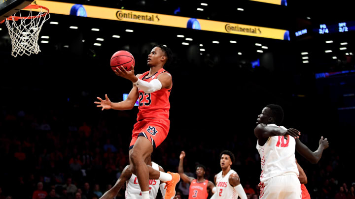 NEW YORK, NEW YORK – NOVEMBER 25: Isaac Okoro #23 of the Auburn Tigers, who is a great fit for the San Antonio Spurs, jumps for a layup in the first half against the New Mexico Lobos. (Photo by Emilee Chinn/Getty Images)