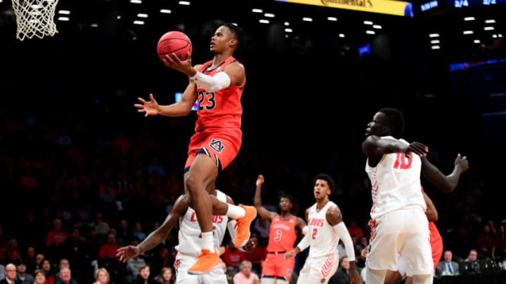 NEW YORK, NEW YORK - NOVEMBER 25: Isaac Okoro #23 of the Auburn Tigers, who's a great fit for the San Antonio Spurs, jumps for a layup in the first half against the New Mexico Lobos. (Photo by Emilee Chinn/Getty Images)