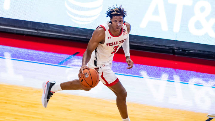 LUBBOCK, TEXAS – NOVEMBER 24: NBA Draft prospect Jahmi'us Ramsey #3 of the Texas Tech Red Raiders brings the ball up the court against the LIU Sharks at United Supermarkets Arena. (Photo by John E. Moore III/Getty Images)