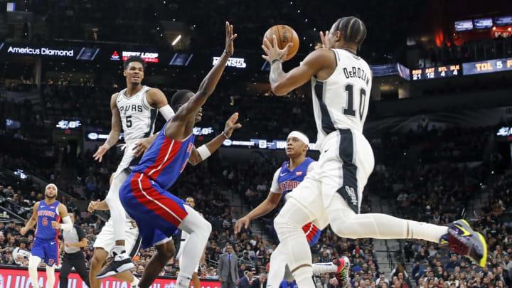 SAN ANTONIO, TX – DECEMBER 28: Dejounte Murray #5 of the San Antonio Spurs passes off to DeMar DeRozan #10 of the San Antonio Spurs against the Detroit Pistons (Photo by Ronald Cortes/Getty Images)