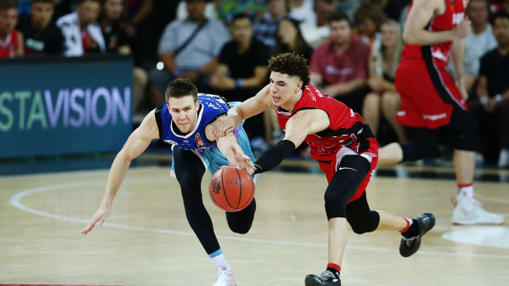 AUCKLAND, NEW ZEALAND – NOVEMBER 30: LaMelo Ball of the Hawks competes for the ball against Tom Abercrombie of the Breakers during the round 9 NBL match between the New Zealand Breakers and the Illawarra Hawks at Spark Arena on November 30, 2019 in Auckland, New Zealand. (Photo by Anthony Au-Yeung/Getty Images)