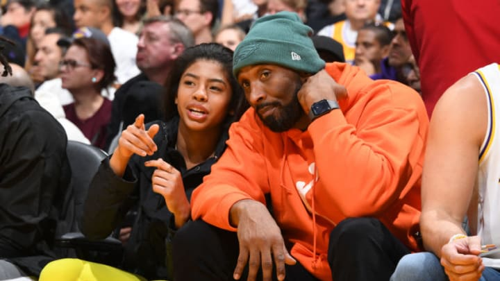 LOS ANGELES, CA - DECEMBER 29: Kobe Bryant and Gianna Bryant attend the game between the Los Angeles Lakers and the Dallas Mavericks on December 29, 2019 at STAPLES Center in Los Angeles, California. NOTE TO USER: User expressly acknowledges and agrees that, by downloading and/or using this Photograph, user is consenting to the terms and conditions of the Getty Images License Agreement. Mandatory Copyright Notice: Copyright 2019 NBAE (Photo by Andrew D. Bernstein/NBAE via Getty Images)