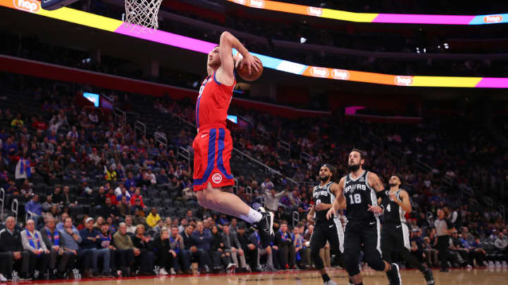 DETROIT, MICHIGAN - DECEMBER 01: Sviatoslav Mykhailiuk #19 of the Detroit Pistons gets in front of the San Antonio Spurs defense for a first half dunk at Little Caesars Arena on December 01, 2019 in Detroit, Michigan. NOTE TO USER: User expressly acknowledges and agrees that, by downloading and or using this photograph, User is consenting to the terms and conditions of the Getty Images License Agreement. (Photo by Gregory Shamus/Getty Images)