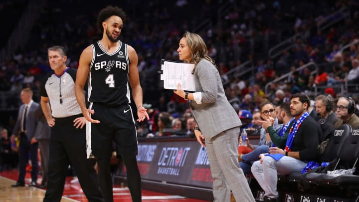 DETROIT, MICHIGAN – DECEMBER 01: Assistant coach Becky Hammon of the San Antonio Spurs talks to Derrick White #4 while playing the Detroit Pistons at Little Caesars Arena on December 01 (Photo by Gregory Shamus/Getty Images)