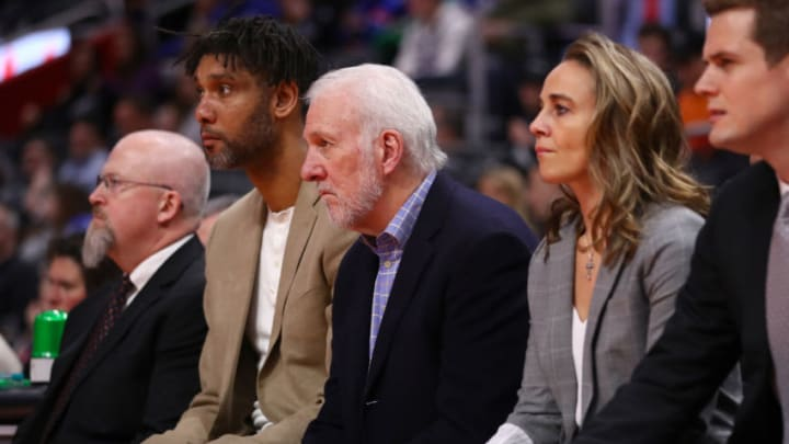 Head coach Gregg Popovich of the San Antonio Spurs sits on the bench with assistants Tim Duncan, Becky Hammon and Will Hardy (Photo by Gregory Shamus/Getty Images)