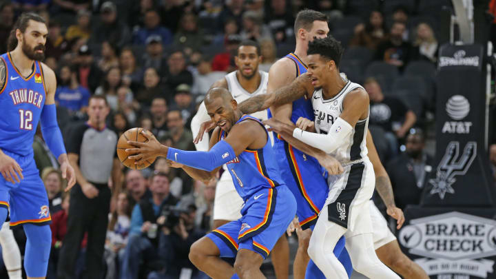 SAN ANTONIO, TX – JANUARY 2: Chris Paul #3 of the Oklahoma City Thunder fights off Dejounte Murray #5 of the San Antonio Spurs during first half action at AT&T Center (Photo by Ronald Cortes/Getty Images)
