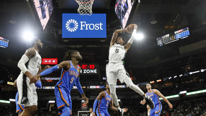 SAN ANTONIO, TX – JANUARY 2: Dejounte Murray #5 of the San Antonio Spurs elevates next to Nerlens Noel #9 of the Oklahoma City Thunder during first half action at AT&T Center. (Photo by Ronald Cortes/Getty Images)