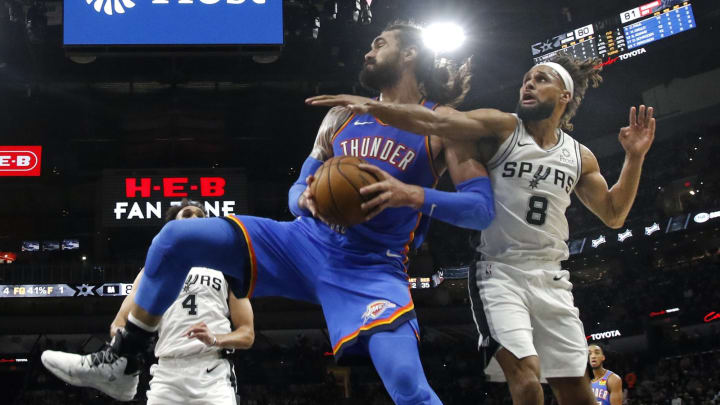 SAN ANTONIO, TX – JANUARY 2: Steven Adams #12 of the Oklahoma City Thunder grabs a rebound next to Patty Mills #8 of the San Antonio Spurs during second half action at AT&T Center (Photo by Ronald Cortes/Getty Images)