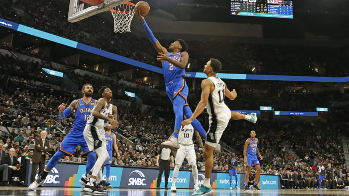 SAN ANTONIO, TX – JANUARY 2: Shai Gilgeous-Alexander #2 of the Oklahoma City Thunder flies past Bryn Forbes #11 of the San Antonio Spurs during second half action at AT&T Center. (Photo by Ronald Cortes/Getty Images)