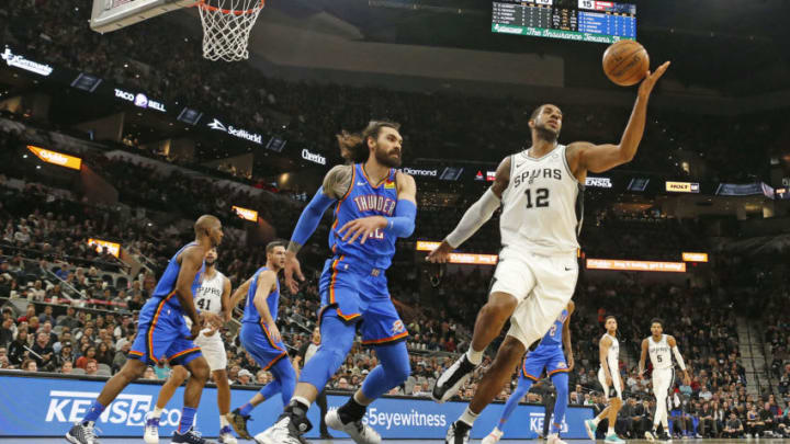 SAN ANTONIO, TX - JANUARY 2: LaMarcus Aldridge #12 of the San Antonio Spurs reaches for a loose ball agains Steven Adams #12 of the Oklahoma City Thunder during first half action at AT&T Center on January 2, 2020 in San Antonio, Texas. NOTE TO USER: User expressly acknowledges and agrees that , by downloading and or using this photograph, User is consenting to the terms and conditions of the Getty Images License Agreement. (Photo by Ronald Cortes/Getty Images)