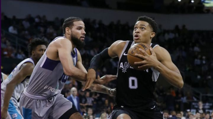 CEDAR PARK, TX - JANUARY 3: Keldon Johnson #0 of the Austin Spurs holds the ball as he drives around Caleb Martin #10 of the Greensboro Swarm during a NBA G-League game on January 3, 2020 (Photo by Chris Covatta/NBAE via Getty Images)