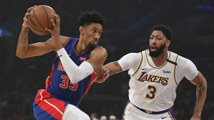 Anthony Davis #3 of the Los Angeles Lakers guards Christian Wood #35 of the Detroit Pistons.(Photo by John McCoy/Getty Images)