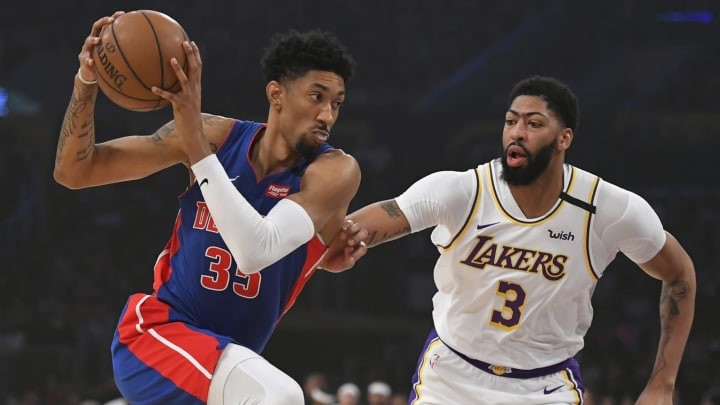 Anthony Davis #3 of the Los Angeles Lakers guards Christian Wood #35 of the Detroit Pistons. (Photo by John McCoy/Getty Images)