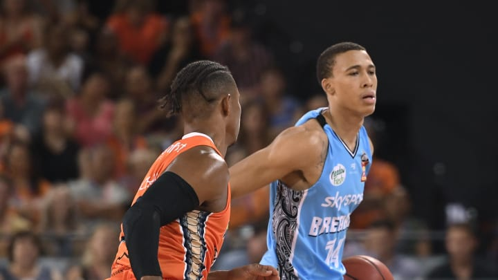CAIRNS, AUSTRALIA – DECEMBER 06: NBA Draft prospect RJ Hampton of the Breakers dribbles looks to get past Scott Machado of the Taipans during the round 10 NBL match. (Photo by Ian Hitchcock/Getty Images)