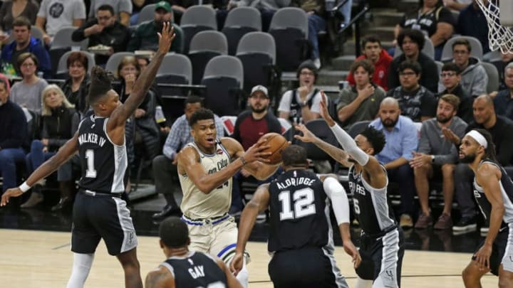 SAN ANTONIO, TX - JANUARY 6: Giannis Antetokounmpo #34 of the Milwaukee Bucks draws the attention of all the San Antonio Spurs during first-half action at AT&T Center (Photo by Ronald Cortes/Getty Images)