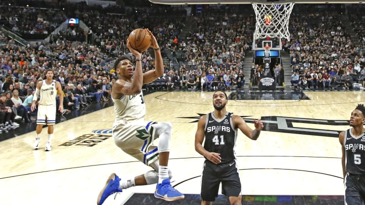 SAN ANTONIO, TX – JANUARY 6: Giannis Antetokounmpo #34 of the Milwaukee Bucks shoots past Trey Lyles #41 of the San Antonio Spurs during second half action at AT&T Center (Photo by Ronald Cortes/Getty Images)