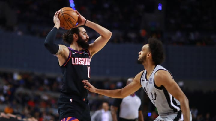 MEXICO CITY, MEXICO - DECEMBER 14: Ricky Rubio #11 of the Phoenix Suns handles the ball against Derrick White #4 of the San Antonio Spurs during a game between San Antonio Spurs and Phoenix Suns at Arena Ciudad de Mexico on December 14, 2019 in Mexico City, Mexico. (Photo by Hector Vivas/Getty Images)