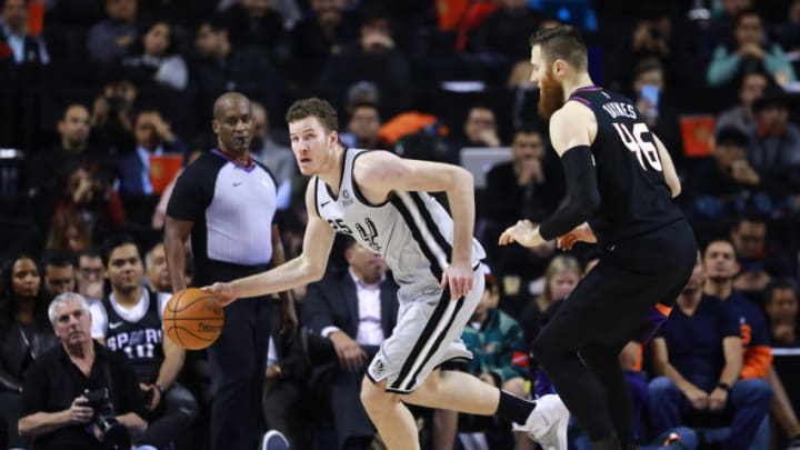 MEXICO CITY, MEXICO - DECEMBER 14: Jakob Poeltl #25 of the San Antonio Spurs handles the ball against Aron Baynes #46 of the Phoenix Suns during a game at Arena Ciudad de Mexico City. (Photo by Hector Vivas/Getty Images)