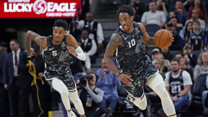 SAN ANTONIO, TX - JANUARY 17: DeMar DeRozan #10 of the San Antonio Spurs and Dejounte Murray #5 push the ball down court against the Atlanta Hawks during second half action at AT&T Center on January 17, 2020 in San Antonio, Texas. Atlanta Hawks defeated the San Antonio Spurs 121-120. NOTE TO USER: User expressly acknowledges and agrees that ,by downloading and or using this photograph, User is consenting to the terms and conditions of the Getty Images License Agreement. (Photo by Ronald Cortes/Getty Images)