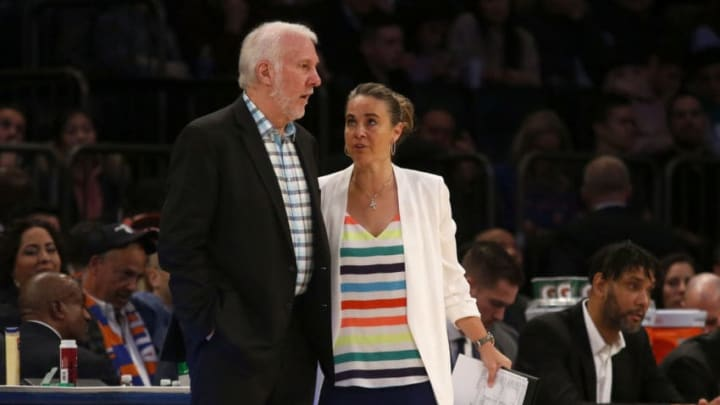 NEW YORK, NEW YORK - NOVEMBER 23: (NEW YORK DAILIES OUT) Head coach Gregg Popovich and assistant coach Becky Hammon of the San Antonio Spurs in action against the New York Knicks at Madison Square Garden on November 23, 2019 in New York City. The Spurs defeated the Knicks 111-104. NOTE TO USER: User expressly acknowledges and agrees that, by downloading and or using this photograph , user is consenting to the terms and conditions of the Getty Images License Agreement. (Photo by Jim McIsaac/Getty Images)