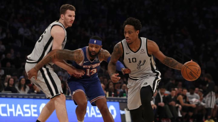 NEW YORK, NEW YORK - NOVEMBER 23: (NEW YORK DAILIES OUT) DeMar DeRozan #10 and Jakob Poeltl #25 of the San Antonio Spurs in action against Marcus Morris Sr. #13 of the New York Knicks at Madison Square Garden on November 23, 2019 in New York City. The Spurs defeated the Knicks 111-104. NOTE TO USER: User expressly acknowledges and agrees that, by downloading and or using this photograph , user is consenting to the terms and conditions of the Getty Images License Agreement. (Photo by Jim McIsaac/Getty Images)