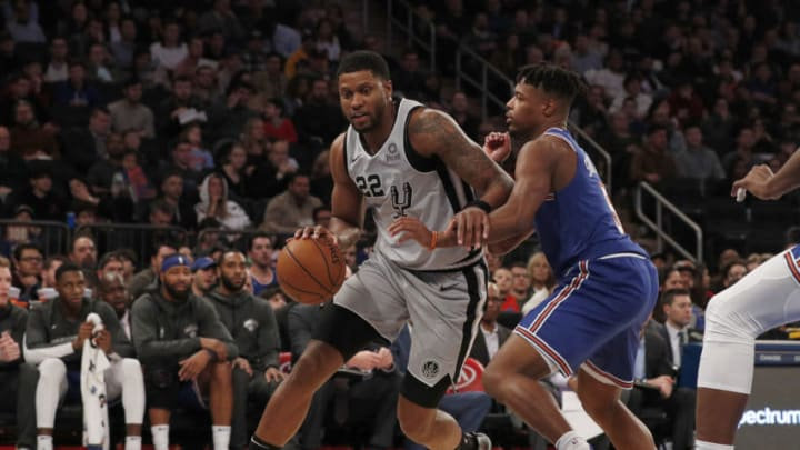 NEW YORK, NEW YORK - NOVEMBER 23: (NEW YORK DAILIES OUT) Rudy Gay #22 of the San Antonio Spurs in action against Dennis Smith Jr. #5 of the New York Knicks at Madison Square Garden on November 23, 2019 in New York City. The Spurs defeated the Knicks 111-104. NOTE TO USER: User expressly acknowledges and agrees that, by downloading and or using this photograph , user is consenting to the terms and conditions of the Getty Images License Agreement. (Photo by Jim McIsaac/Getty Images)