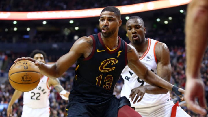 TORONTO, ON - DECEMBER 31: Tristan Thompson #13 of the Cleveland Cavaliers dribbles the ball as Serge Ibaka #9 of the Toronto Raptors defends during the second half of an NBA game at Scotiabank Arena on December 31, 2019 in Toronto, Canada. NOTE TO USER: User expressly acknowledges and agrees that, by downloading and or using this photograph, User is consenting to the terms and conditions of the Getty Images License Agreement. (Photo by Vaughn Ridley/Getty Images)