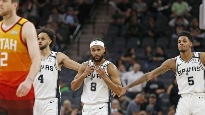 SAN ANTONIO, TX - JANUARY 29: Dejounte Murray #5 of the San Antonio Spurs congratulates Derrick White #4 late in second half action at AT&T Center (Photo by Ronald Cortes/Getty Images)