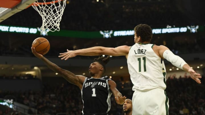 Lonnie Walker IV of the San Antonio Spurs goes up for a layup over Brook Lopez. (Photo by Stacy Revere/Getty Images)
