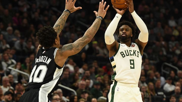 MILWAUKEE, WISCONSIN – JANUARY 04: Wesley Matthews #9 of the Milwaukee Bucks shoots over DeMar DeRozan (Photo by Stacy Revere/Getty Images)