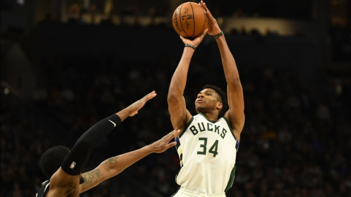 MILWAUKEE, WISCONSIN - JANUARY 04: Giannis Antetokounmpo #34 of the Milwaukee Bucks shoots over Rudy Gay #22 of the San Antonio Spurs during the second half of a game at Fiserv Forum on January 04, 2020 in Milwaukee, Wisconsin. NOTE TO USER: User expressly acknowledges and agrees that, by downloading and or using this photograph, User is consenting to the terms and conditions of the Getty Images License Agreement. (Photo by Stacy Revere/Getty Images)