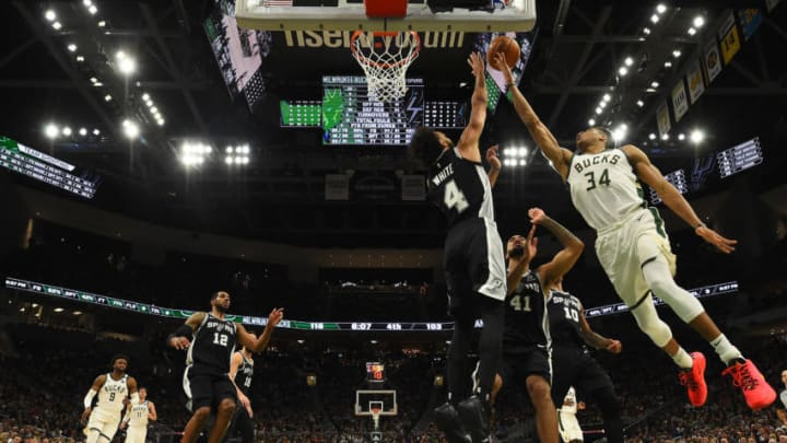 MILWAUKEE, WISCONSIN - JANUARY 04: Giannis Antetokounmpo #34 of the Milwaukee Bucks shoots over Derrick White #4 of the San Antonio Spurs during the second half of a game at Fiserv Forum on January 04, 2020 in Milwaukee, Wisconsin. NOTE TO USER: User expressly acknowledges and agrees that, by downloading and or using this photograph, User is consenting to the terms and conditions of the Getty Images License Agreement. (Photo by Stacy Revere/Getty Images)